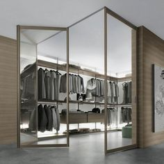 Using Internal Sliding Glass Doors for Your Home Setup: Outstanding Commercial Interior Glass Doors Internal Contemporary Design House Enlivened With Modern Walk In Closet Also Magnificent Folding Door And Various Menswear Decorations ~ workdon.com Doors Designs Inspiration