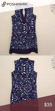 Puzzle blue High collar, open v top. Solid blue band on bottom of skirt. Petite size. Jessica Howard Dresses