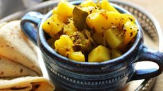 Delicious Hot and Spicy Bombay Potato Cooked Very Simply with a Warming Bite of Mustard Seeds and Fragrance of Curry Leaves Bombay Potato Recipe, Aloo Recipes, Potato Recipes, Potato Dishes, Veg Recipes, Side Dishes Easy, Tasty Dishes, National Potato Day