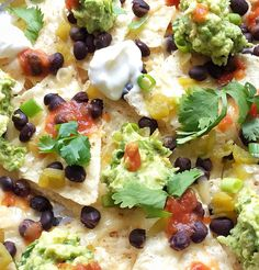 Nachos for Two: Perfectly portioned snack recipe for Game Day. Made with black beans, low-fat cheese, cilantro and guacamole, your party friends will love this. via @MealMakeoverMom