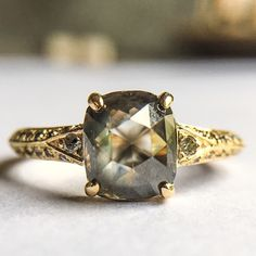 Digby and Iona 1.4ct smoky / olive colored diamond and salt & pepper pave in 18k yellow gold.