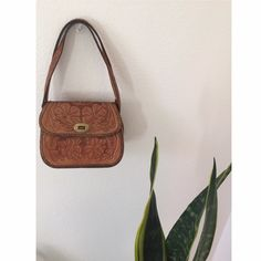 Vintage leather handbag Beautiful vintage embossed handbag made in Mexico perfect condition inside and out. Genuine leather floral print. Vintage Bags