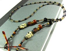 Black and Amber Eyeglasses Chain, Hand Crafted with Speckled Beads | TheTwistedRedhead - Accessories on ArtFire
