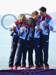 (L-R) 470 Women's sailors Saskia Clark and Hannah Mills of Great Britain and 470 Men's sailors Luke Patience and Stuart Bithell of Great Britain celebrate winning silver medals in their classes on Day 14