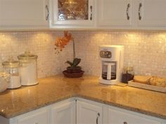 Planning to tile the kitchen backsplash one of these days, I like mother of pearl oyster white. paulabrici