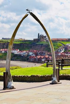 Whalebone Arches in Whitby, North Yorkshire, England. In the background is Whitby Abbey. Yorkshire England, Yorkshire Dales, North Yorkshire, England And Scotland, England Uk, Whitby England, Great Places, Places To See, Beautiful Places