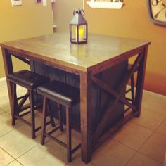 Partially-bar-height breakfast table with faux zebra wood