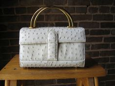 Vintage White Leather Handbag Purse / Saks Fifth Avenue / 50s 60s. $75.00, via Etsy.