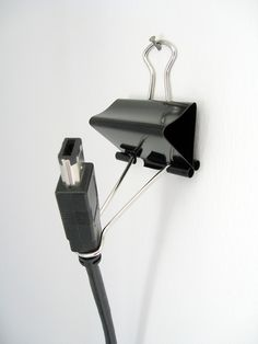 For the toaster plug. Tired of chasing it.   Binder clip cable holder by Matti Mattila, via Flickr