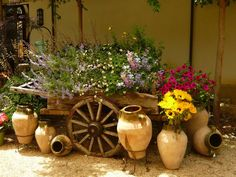 Love this old wagon loaded with flowers of all colors and other garden decor. This is my kind of stuff, love it!!