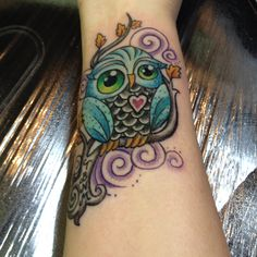 Genevieve. My new owl tattoo.  ( i dont usually like owls but this one is super cute!)