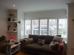 Modern lounge square bay fitted with shutters and tposts