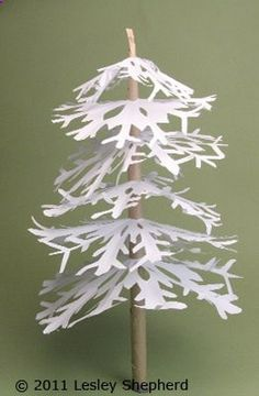 DIY miniature winter trees. These pretty little trees are made from paper snowflakes (instructions). The trunk can be made from recycled paper grocery bags.