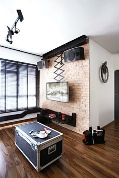 Space Sense - Photo 11 of 11 | Home & Decor Singapore. The concept of the brick feature wall, which hides wiring, was sparked by the huge speakers purchased by the homeowners as designer, Kelvin, wanted a design that matched the equipment well.