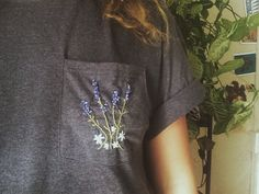 MADE TO ORDER - please allow 2-3 weeks for your shirt to be made and shipped  Stone grey hanes pocket tee embroidered with a bouquet of Lavendar daisies :-))  Feel free to request other colors and flowers! No extra charge, I appreciate something different  Unisex sizes Please see size chart to make sure you select a size that will fit comfortably!  ***Questions? Custom Order? message me!***  -Facebook: facebook.com/TheArtSwallow  -Instagram: Instagram.com/TheArtSwallow  -Tumblr…