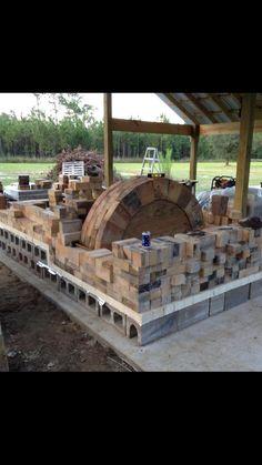 Brian Nettles' new wood/salt kiln under construction. MS Joseph Geil, resident potter and builder
