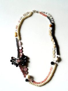 A designer knock-off. A bit time-consuming, but OH SO EASY, and inexpensive, too. Anthro Necklace Week - Petalouda Necklace »Flamingo Toes