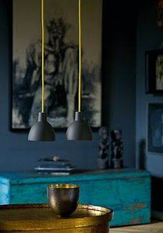 Color combination and mixture of old and new make this a very inviting space. Modern light fixtures are Toldbod 120 pendant lamps by Louis Poulsen