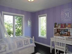 Girls room with striped paint and monogram