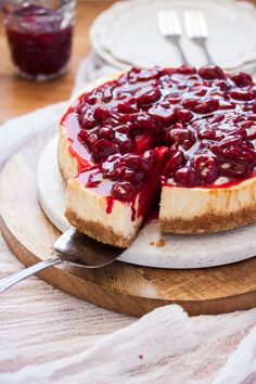 This easy Baked Cheesecake is smooth and creamy on the inside and topped with a luscious Fresh Cherry Sauce. This is the best baked cheesecake recipe.