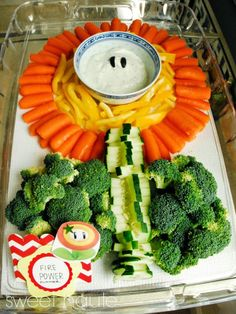 Fire power flower - veggie tray with ranch, carrots, bell peppers, cucumbers, and broccoli