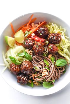 Slow cooker Sriracha meatballs top healthy buckwheat soba noodles and fresh vegetables and herbs to make a simple Asian inspired salad for lunch or dinner.
