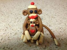 Used Premo and Sculpy III for this monkey and baby. I used an extruder for arms, legs and tails, everything else was formed by hand including the heart on the baby monkey.