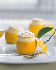 A show off dessert. Perfect for a French dinner party one day. Mini lemon souffles. - Via Martha Stewart.