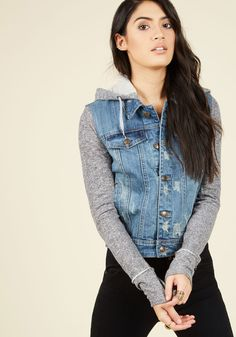 For today's downtown trek, you couldn't wait to show off your casual-cool outfit, which you've topped off with this hooded jacket. Complete with a denim vest-like bodice, and soft, grey sleeves, this pocketed layer makes for a noteworthy style that will be admired from your favorite cafe to your go-to record store!