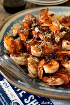 Bacon-Wrapped Gulf Shrimp with Blue Cheese Butter and Port Reduction - An incredible shrimp recipe inspired by the Gulf Coast plus a culinary tour of the Gulf region.