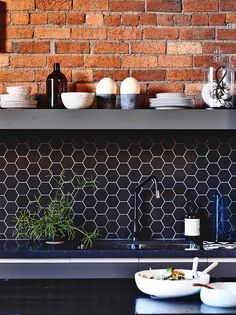 Love the black tiles against the brick wall!
