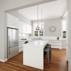 Classic modern white kitchen design. Solu-slimline handles, gloss polyurethane door fronts and Caesarstone benchtops.