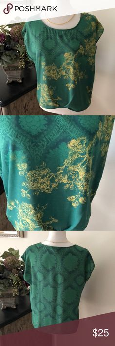 CAbi Green with Envy #557 Top S Excellent gently used condition. Emerald green with mustard yellow floral pattern. Size small. CAbi Tops Blouses