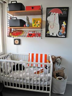 I don't have kids and I'm not planning on having kids anytime soon, but I love this nursery! String shelves and a Moomin print!