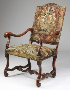 French Provincial armchair with needlepoint upholstery, late 19th or early 20th century, the backrest centering a medieval figure in a pastoral setting, the seat with foliate sprays in a pallette of blue, cream and red, the whole rising on carved legs terminating in scroll feet conjoined by an H-stretcher.