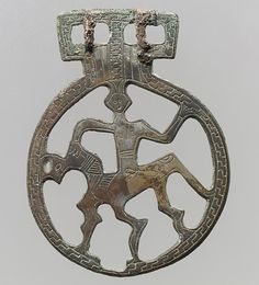 Openwork Belt Fitting. 7th century, Alamania, Frankish, cast copper alloy - tinned surface, engraved decoration; two integral posts on reverse; iron tongues.