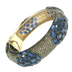 1stdibs - Sapphire and Pave Diamond Cluster Bangle explore items from 1,700  global dealers at 1stdibs.com