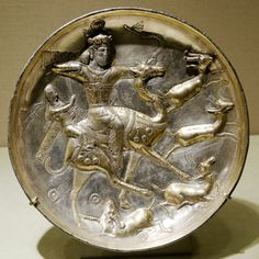Plate with a hunting scene from the tale of Bahram Gur and Azadeh, Sasanian artwork.5th century, made ofgilded silver.  Courtesy & currently located at theThe Metropolitan Museum of Art, New York. Photo taken byMarie-Lan Nguyen