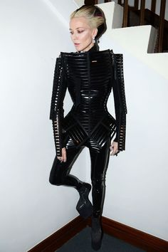 A History Of Women Who Love To Wear Black #refinery29 http://www.refinery29.com/all-black-outfits-women-history#slide14 Daphne Guinness The inimitable Ms. Guiness, ever cloaked in rubber, lacy, strappy black finery. With a penchant for wasp waists and alien-looking platforms, she's like a Giger drawing come to life. All hail the mistress of fashion's dark side!