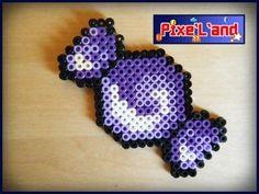 Pixel Art en perle Hama Bonbon Papillotte Pixel Art réalisé en perle Hama. Taille : 10,5cm X 5,5cm Disponible en plusieurs coloris sur simple demande.  *Pensez à la customisation de votre Pixel art !! : Porte clé, aimant, cadre, pot etc...*