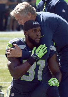 (This picture says a lot!) SEATTLE, WA - SEPTEMBER 27: Head coach Pete Carroll of the Seattle Seahawks gives a quick hug to strong safety Kam Chancellor #31 of the Seattle Seahawks before the game against the Chicago Bears at CenturyLink Field on September 27, 2015 in Seattle, Washington. (Photo by Steve Dykes/Getty Images) Seattle Seahawks Team Photos - ESPN