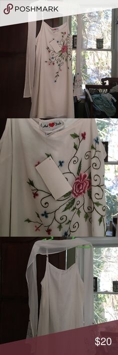 Embroidered white dress Lovely white sheer dress with embroidered floral design, perfect for the Spring/Summer.  Originally bought in Hawaii. Dresses