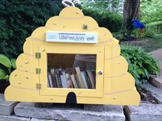 Laurie Miller. St. Louis, MO. I am a beekeeper so I thought it only natural that I pay homage to the bees! I designed the library, Bob Carmody built it and Greta Van Campen pained the bees! A group effort to bring it to reality. Books are a variety of adult and children's books.
