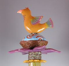 """Primitiva Pottery and Tile has cool examples of garden totems and """"tree jewelry"""" and they are from Washington"""
