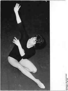 Gymnast Ute Starke performing dance move on floor exercise (1960).