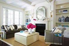 McGill Design Group: Modern classic living room built-ins on either side of traditional fireplace filled with ...