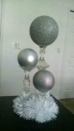 Discover thousands of images about DIY Dollar Tree candlesticks. 2 glued together for medium height, and 3 for the tallest. Place large ornaments on top, or paint Styrofoam spheres. Wedding Centerpieces, Wedding Decorations, Dollar Tree Centerpieces, Candlestick Centerpiece, Birthday Decorations, Silver Decorations, Ball Decorations, Christmas Crafts, Christmas Decorations