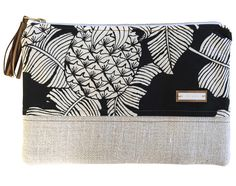 This large clutch or pouch is perfect all your hand-carrying needs. Easily able the fit your cell phone (pocket inside), wallet, makeup, and other accessories.