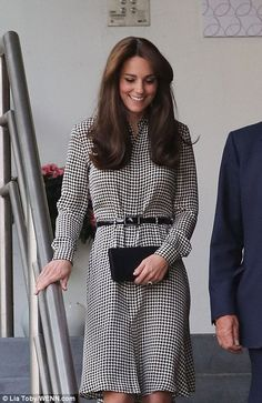 The Duchess smiles as she makes her way around the centre