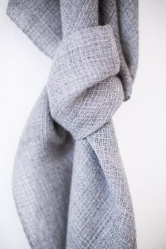 Woven in soft gray alpaca in a subtle pattern of tiny squares, Alize is refined and simply elegant. This piece will be the quiet finishing touch to any outfit.